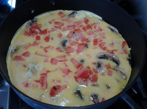 Add chopped tomatoes. Mixture should be bubbling gently.  Reduce heat to medium-low. Season...