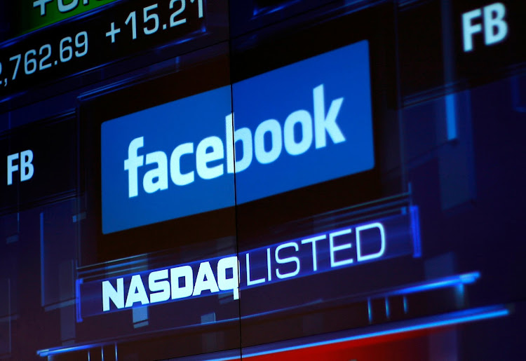 Monitors display the Facebook Inc stock during morning trading at the Nasdaq market site in New York, US. (File photo)