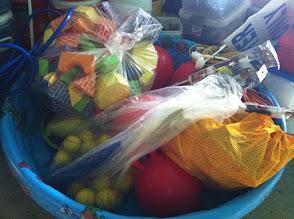 Photo: Sibling blocks, bouncing balls, soft baseballs, slingshots, American flags