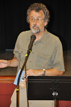 Photo: Dennis Caswell reads one of his poems.