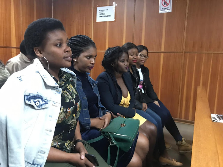 Walter Sisulu University student Sibongile Mani in court with supporters on Friday.