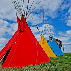 Jewels of Montana by Barbara Brock - Buildings & Architecture Other Exteriors ( indian teepees, red, native american tents, cloudy skies, teepees, native american )