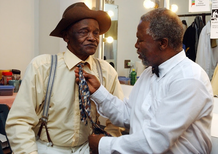 John Kani adjusts Winston Ntshona 's tie prior to going on stage for Sizwe Banzi is dead, the Tony Award winning play that was staged on July 1, 2006 at the Rhodes Theatre in Grahamstown for the first time since 1984. Picture: IVOR MARKMAN.