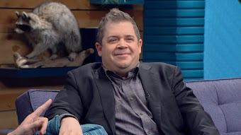 Patton Oswalt Wears a Black Blazer and Dress Shoes