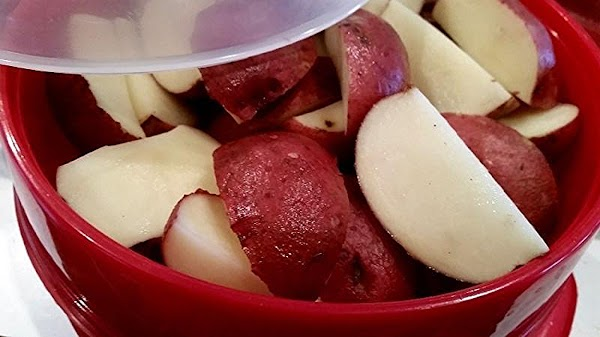 Cut washed potatoes in half. I used a few medium potatoes and cut into...