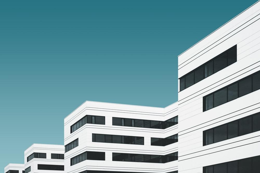 white concrete building illustration hospital money saving ideas