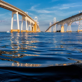 Water view of the Bridge by Carol Ward - Buildings & Architecture Bridges & Suspended Structures ( water, chesapeake bay bridge, below, reflections, bridge spans, chesapeake bay, bridge, architecture )