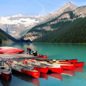 canoes on Lake Louise by Morris Fremar - Landscapes Waterscapes