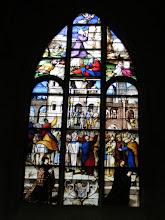 Photo: A sign in the sacristy notes the restoration of some of the stained glass is now underway.