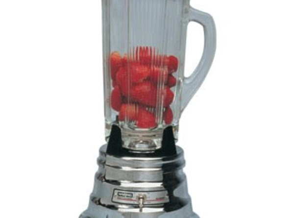 Add strawberries to blender. Cover blender and start at a lower setting (so as...