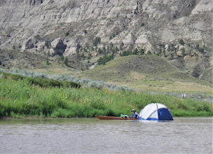 Photo: Helen chases down Casey's tent blown into the river.
