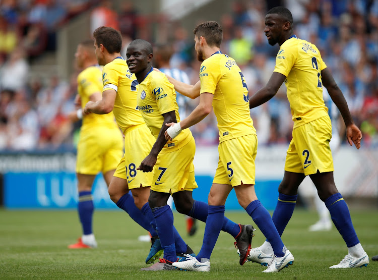 Chelsea's N'Golo Kante celebrates with teammates after scoring their first goal in a 3-0 Premier League win away at Huddersfield Town at John Smith's Stadium on August 11, 2018.