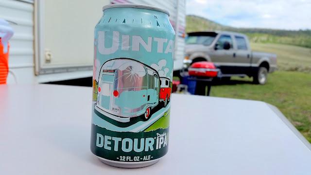 Enjoying a beer back at camp