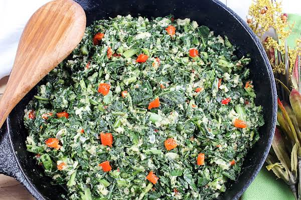Creamed Collard Greens With Bread Crumbs In A Cast Iron Skillet.