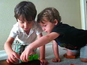 Photo: Two Boys Build Piggy Forts