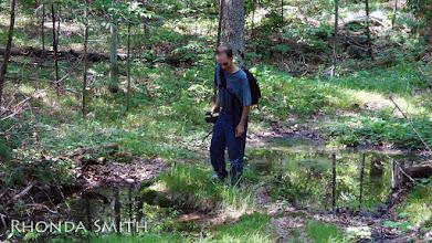 Photo: Steve walking along a creek.