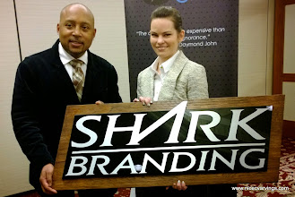 Photo: Melissa Jones of www.nicecarvings.com presenting a nice sign for Daymond John of ABCs Sharktank.