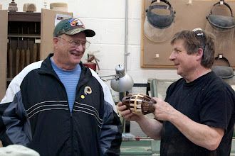 Photo: Bob Grudberg and Mike have fun with the Bob's open segmented hollow form.