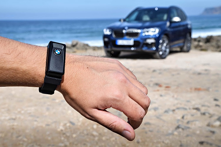 The company has introduced a Land Rover style activity wrist key for the X3. Picture: BMW