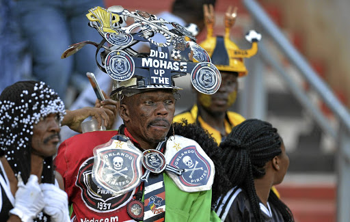 Oblivious: Fans at the Carling Black Label Champion Cup match between Orlando Pirates and Kaizer Chiefs at FNB Stadium on Saturday. Picture: LEFTY SHIVAMBU/GALLO IMAGES