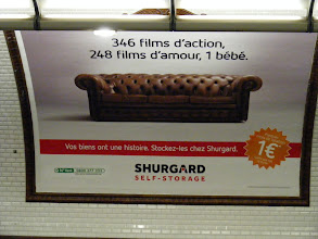 """Photo: There's always at least one Metro ad displaying the wry French sense of humor, as this one with a picture of a couch: """"346 action films, 248 romance movies, one baby."""" Ha! It's actually an ad for a self-storage company, including the text: :Your property has a story."""" The Metro can be counted on to surprise in other ways. I find myself traveling along today across from someone rolling their own cigarette from a Camel brand kit designed for same, with loose tobacco, papers, and even filters. The job was expertly done by someone with considerable experience in this task, but I was quite nonplussed to see it be a young blond woman who appeared to be barely out of her teens!"""