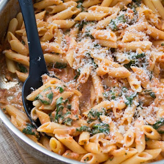 Penne with Sun-Dried Tomato Cream Sauce and Spinach.