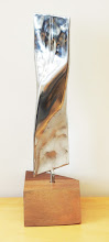 Photo: TWIST TOO - 23H X 8W X 9D Forged and Polished Mild Steel, Mahogany, Interactive Kinetic - Rear View