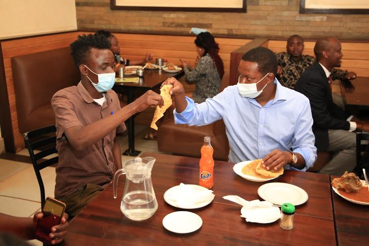 Machakos governor Alfred Mutua sharing a chapati./COURTESY