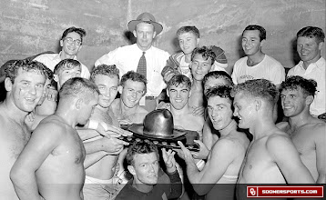 Photo: Wilkinson with team and Golden Hat in Cotton Bowl locker room after 20-14 victory against Texas in 1948.
