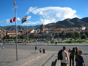 Photo: This is the central square of Cuzco, Peru. It is called Plaza de Armas. The multi-colored flag is the symbol of the city (no association with gay pride).