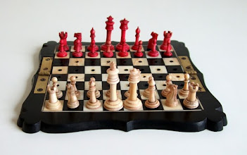 Photo: Travel set with more 'up-market' ivory & ebony board, but still on the same pattern.   Eagle-eyed viewers will see the pieces placed the 'other way round'. The explanation and other images of the set can be seen here:  https://picasaweb.google.com/mickdeasey/TravelAndPocketChessSets#5392810333628902930  I wonder if the board/pieces originated together? There is a marked variation in the various boards sets I own, so that it is not always easy to transpose them - but they do fit their 'own' board!