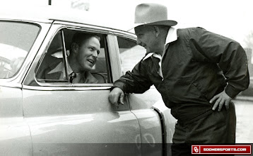Photo: Wilkinson, seated in car, shares a moment with an associate.