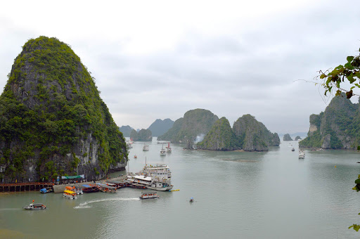 ha-long-bay-ships-and-dock.jpg -  A popular stopping place along Ha Long Bay in Vietnam features a dock, shops and a chance to swim.