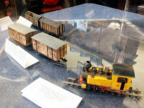 Photo: 019 Display photo 3. David Lowe's Queensland sugar cane Fowler loco alongside Peter Dale's metre gauge French rolling stock .