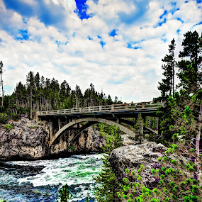 Bridge over fast water by John Broughton - Landscapes Waterscapes ( clouds, national parks, trees, bridge, river )