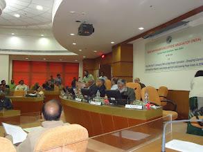 Photo: Com. H. Muthu, addressing the seminar
