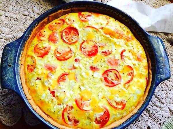 Tomato And Buttery Cheese Make This Quiche A Winner!
