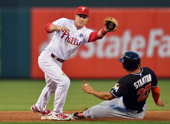 PHILADELPHIA, PA - JUNE 23: Chase Utley #26 of the Philadelphia Phillies catches the ball as Giancarlo Stanton #27 of the Miami Marlins slides safe into second base on a wild pitch in the third inning at Citizens Bank Park on June 23, 2014 in Philadelphia, Pennsylvania. (Photo by Drew Hallowell/Getty Images)