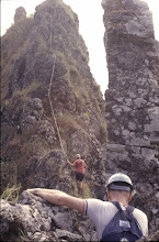 Photo: Climbing Olomana's third peak - Chuck Godek and Herman Medeiros in red shirt.