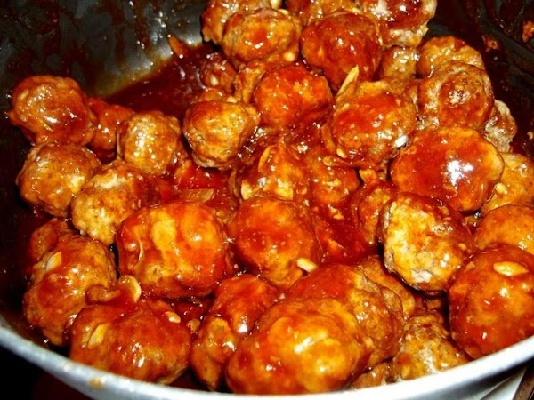 Add the meatballs, coating each with sauce. Heat though for about 5 minutes. Serve...