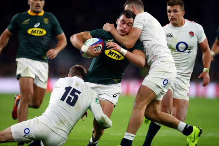 Jonny May of England with a very high tackle on Jesse Kriel of South Africa during the Castle Lager Outgoing Tour match between England and South Africa at Twickenham Stadium on November 3 2018 in London, England.