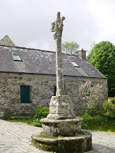 Photo: This small monument outside is a simple example of a calvaire, a stone cross decorated with scenes of Christ's suffering. Much more elaborate examples, dating from the 16th and 17th centuries, are found in other towns and villages, and are a particular trademark of southwest Brittany.
