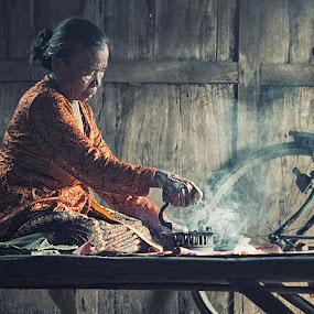 Ironing by German Kartasasmita - People Portraits of Women ( senior citizen )