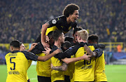 Axel Witsel of Borussia Dortmund celebrates his teams second goal scored by Julian Brandt with his teammates during the UEFA Champions League group F match between Borussia Dortmund and Inter at Signal Iduna Park on November 05, 2019 in Dortmund, Germany.