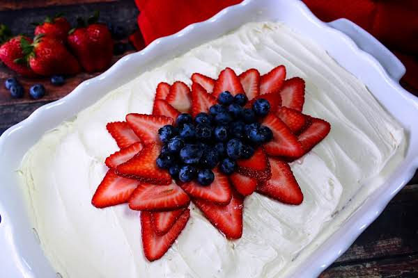 Nonna Rosa's Cream Cake Decorated With Fresh Strawberries And Blueberries.