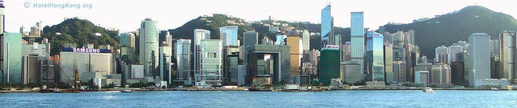 """Photo: Panoramic photo of Hong Kong waterfront skyline near """"Victoria Harbour"""""""