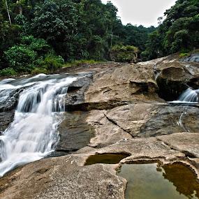 climbing by Cristobal Garciaferro Rubio - Nature Up Close Rock & Stone ( water, mountain, waterfall, man, river )