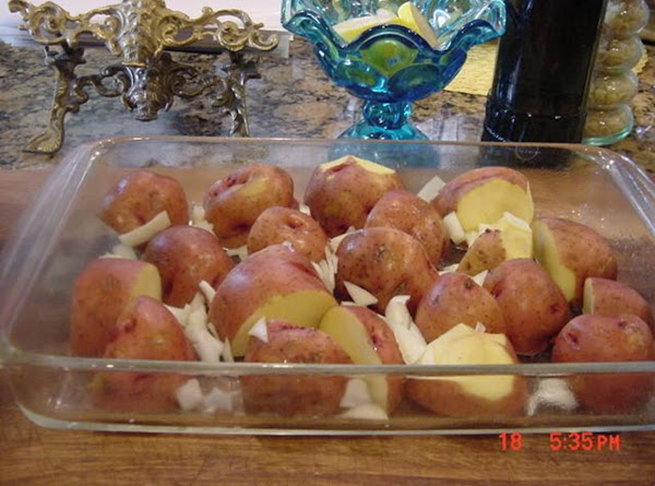 Place potatoes in a single layer in prepared dish, and top with onion.In a...