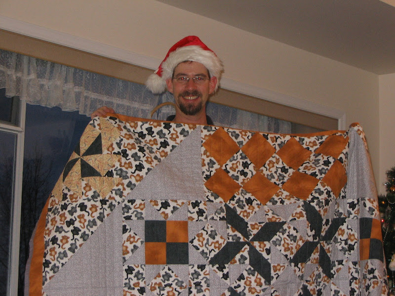 Photo: Sean and the quilt I made him for Christmas 2006