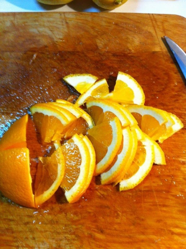 Wash oranges and lemons and cut ends off. Cut in quarters and remove white...